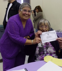 Rosie presenting Martha Parrish a certificate form the club
